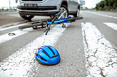 Road accident with car and broken bicycle
