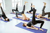 Group of people practising yoga indoors