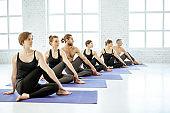 People practising yoga in the studio