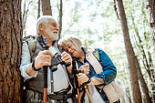 Senior couple hiking in the forest