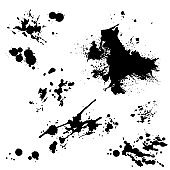 black ink splashes on a white background