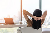 Life quality, living balance and carefree mental health concept with young woman take it easy working and resting in luxury business city hotel or at home office with computer pc laptop on desk