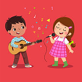 Cute boy playing guitar and little girl singing on red background