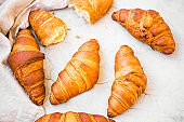 Freshly baked croissants top view, fresh french croissants, breakfast buns