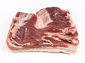 raw pork belly isolated on white copyspace closeup