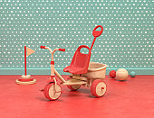 Wood and plastic vintage style playroom and toys with tricycle, velocipede on green and red background, 3d Rendering