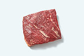 Fresh organic raw meat for roasting with shadows on a white background, copy space. Flat lay
