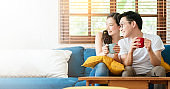 happiness asian couple family marry  enjoy morning together with love and relation on sofa  home interior background