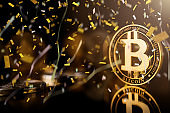 1st prize block chain cryptocurrency business strategy ideas concept  bit coin on reflection floor dark color tone with victory celebrate confetti paper shoot