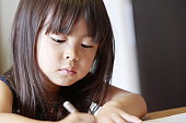 studying Japanese girl at home (4 years old)