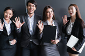 group of smart young asian businessmale and female formal dress teamwork laugh smile standing hand point portrait confident and leadership determination modern office design background