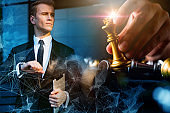 caucasian businessman investor with golden chess board game strategy ideas concept