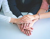 Office people putting hand together for business team success concept