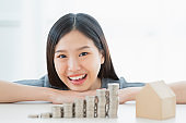 happiness asian woman hand with coin stack financial business ideas concept