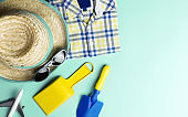 Summer travel fashion and toy for kid on blue copy space pastel