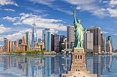 Statue of Liberty and New York City Skyline with Manhattan Financial District, World Trade Center and Water of New York Harbor, NY, USA.