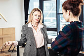Stylish woman feeling unsatisfied with work of trainee