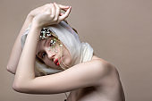Fashion model with white silk fabric on hair showing nice poses