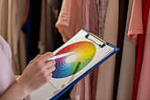 Process of working as a designer of women's clothing, choosing a color.