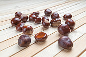 scattered on wooden table top pile of fruit chestnuts