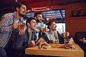 Friends fans watch sport tv in the pub