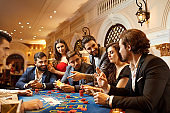 A group of people playing gambling in a casino
