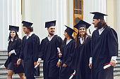 Group of students graduates go against the university college.