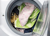 dirty laundry in the washing machine, close-up