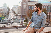 Handsome bearded man sightseeing at the city