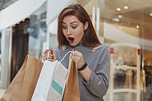 Beautiful young woman shopping at the mall