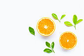 Fresh orange citrus fruit with leaves isolated on white background.