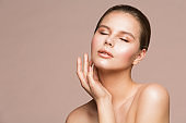 Woman Beauty Portrait, Beautiful Model Touching Neck by Hand, Girl Skin Care and Treatment