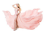 Woman Flying Pink Dress, Fashion Model in Long Waving Gown, Fluttering Fabric on White