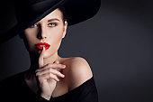 Woman Black Hat, Elegant Fashion Model Beauty Portrait, Finger on Lips Silent Gesture