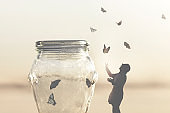 surreal image of a woman who gives freedom to butterflies captive in a vase