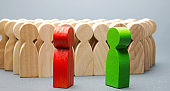 Red and green people stand in front of a crowd. Two opponents. Conflict of interest. Dispute. Search for compromises. Social problems. Business competition. Candidates Political Debate