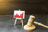 Wooden hammer of a judge and a stand information graphics. Rising crime. Improving efficiency of the judicial system, countering corruption. growth of conviction. selective focus. Sentence statistics