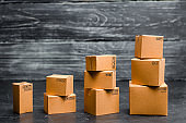 Cardboard boxes are stacked incrementally. Sales growth and increase in exports of goods and services. Warehouse products and equipment. The concept of packing goods, sending orders to customers.