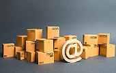 Lots of boxes and email symbol, commercial AT. shopping online. development of Internet network trade, advertising services. E-commerce. sales of goods and services through online trading platforms.