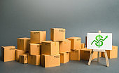 Plenty of cardboard boxes and sign with a dollar symbol green up arrow. rate growth of production of goods and products, increasing economic indicators. Increasing consumer demand. Trade balance