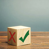 Wooden block with a green check mark. The concept of choice and making the right decision. Business management. Plan, planning. Referendum
