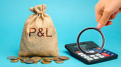 Money bag with the word Profit & loss and calculator. Business analytics and report. Company financial performance. Cash flow generation. Profit, income, expenses, revenue. ROI. ROR. P&L
