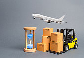 Yellow Forklift truck with cardboard boxesa airmail plane and a sand hourglass. Express delivery concept. Optimization of logistics, improving efficiency. Temporary storage, limited offer Distribution
