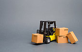 Yellow Forklift truck with cardboard boxes. Increase sales, production of goods. transportation, storage of cargo and goods. Freight shipping, delivery of goods. Logistics and infrastructure. retail