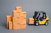 Yellow Forklift truck brings the box to a stack of boxes. Industry and Production. warehouses and transportation. raise economic indicators. exports, imports. sales rise. increased production