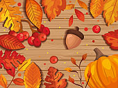 leafs autumn in background wooden with nuts fruits