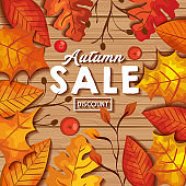 autumn sale in background wooden with leafs