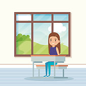 girl child in the classroom with window and desk