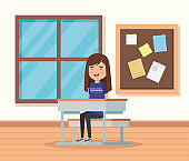 girl child in the classroom with note board and desk