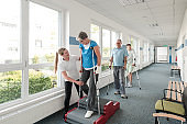 Seniors in rehabilitation learning how to walk with crutches